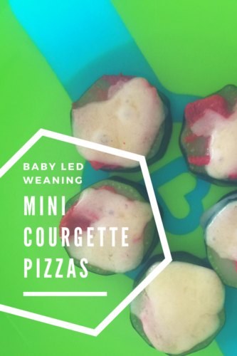 baby led weaning zucchini pizzas sat on a green munchkin plate