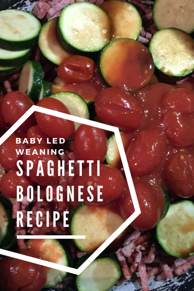 baby led weaning spaghetti bolognese cooking in the pan full of courgette and fresh tomatoes