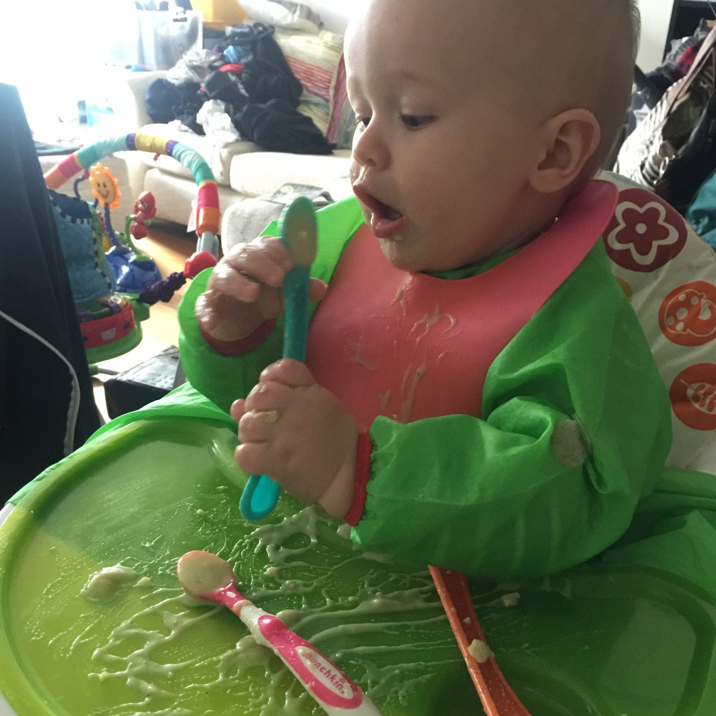 Dexter eating leek and potato soup for babies from pre loaded spoons while sat in his high chair