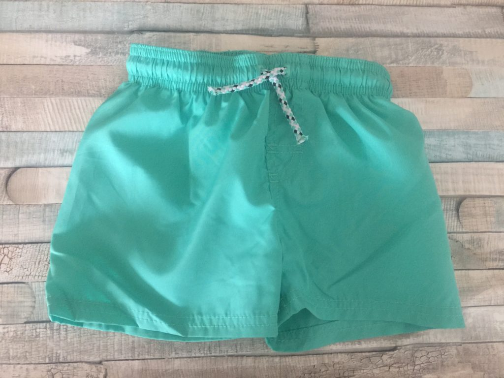 A pair of H M Baby Swim shorts in aqua / turquoise