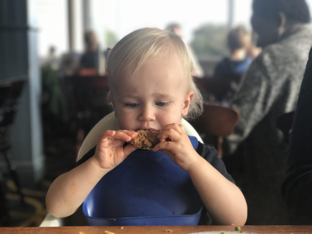 Dexter biting into a chicken strip in the britannia inn liverpool