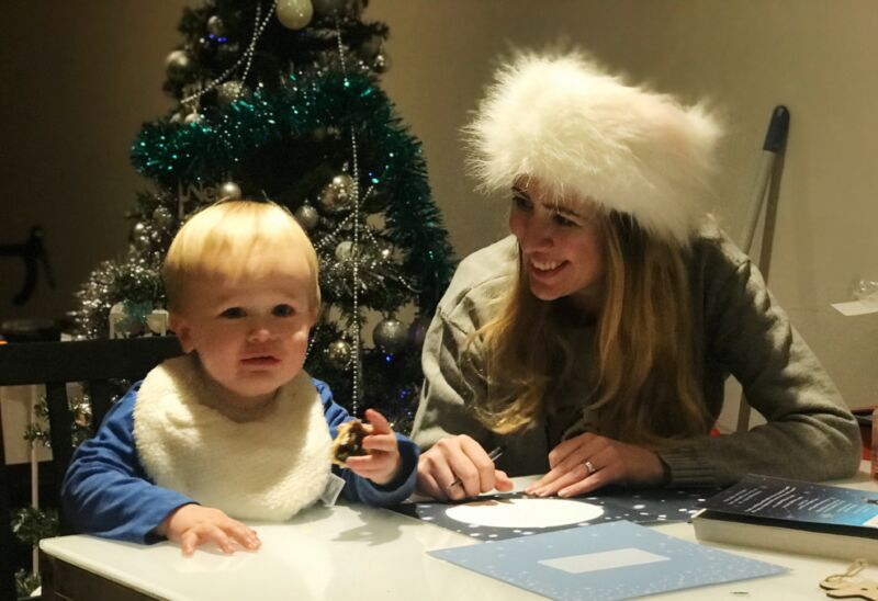 Mummy and Dexter sitting at the table writing Christmas cards