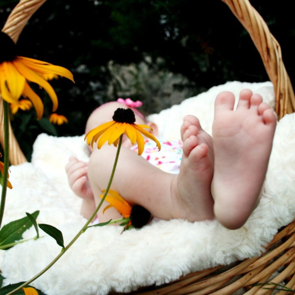 A newborn baby placed in a wicker basket. When is the right time to have another baby?