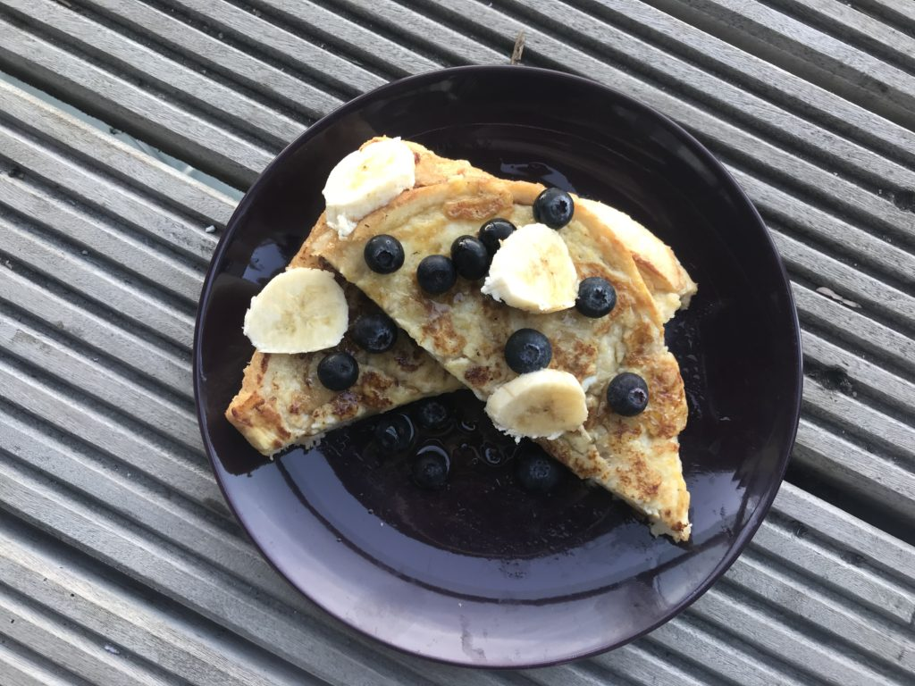baby led weaning french toast sandwich topped with blueberries and bananas