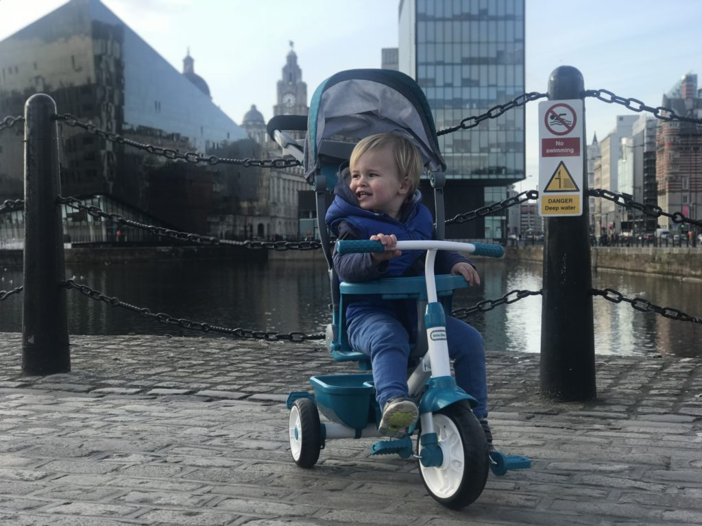 Dexter on his little tikes 4 in 1 trike next to the Albert Dock