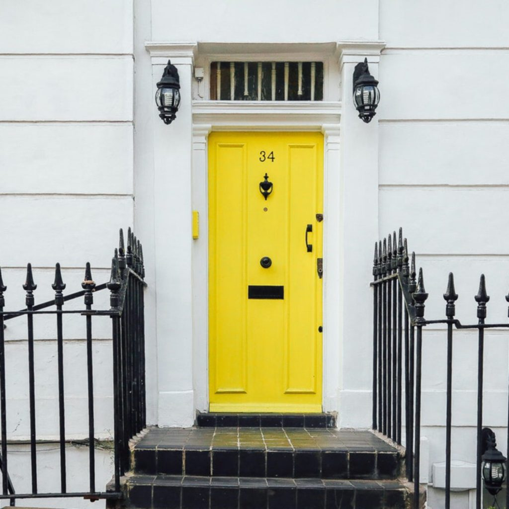 White house with a yellow front door