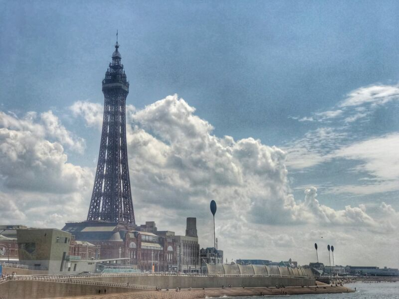 a shot of blackpool with the tower and blue cloudy skies behind it