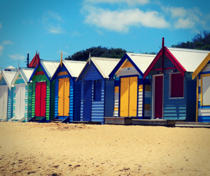 coloured huts on the beach in brighton