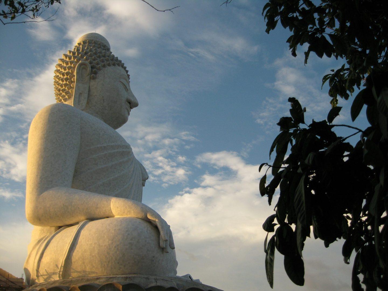 the big buddha in phuket with cloudy skies behind him