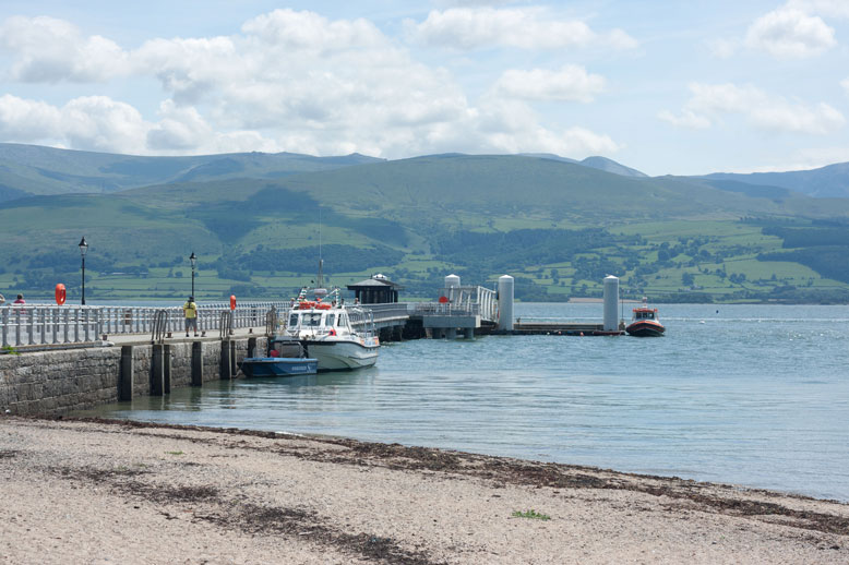 Beaumaris, another North Wales town, the jetty, rocky beach, sea between the mainland and Anglesey
