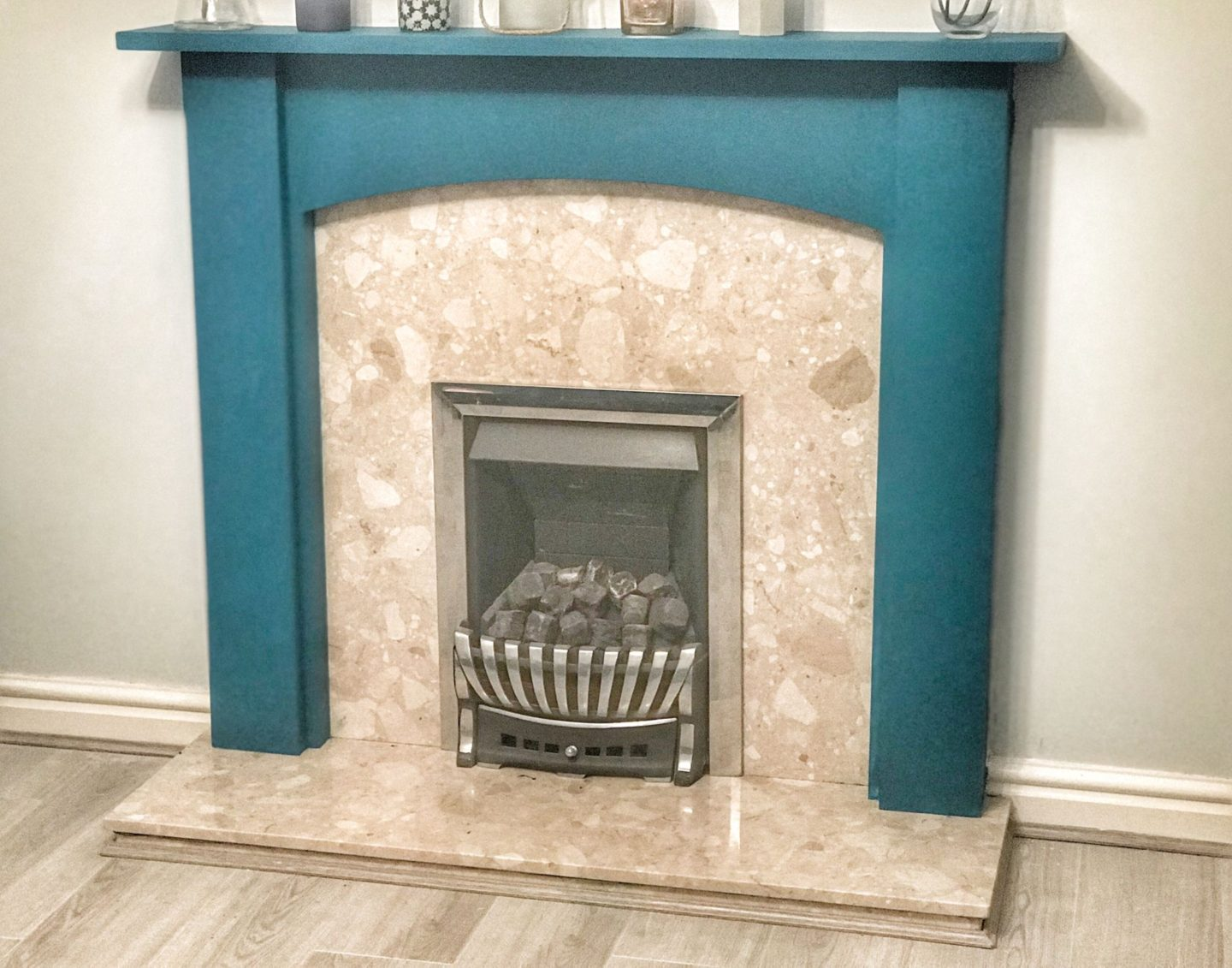 the finished result: the fireplace's surround is now teal