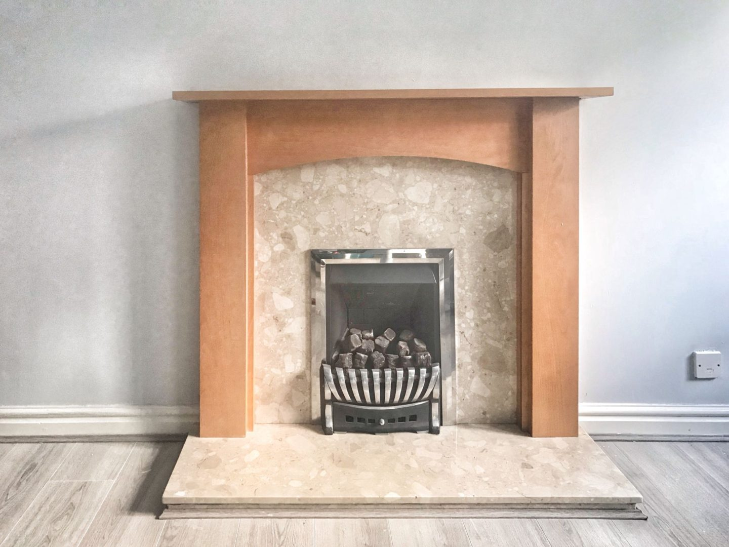 the fireplace before we painted it, brown wooden surround