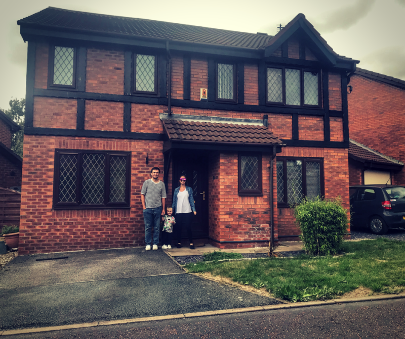 myself, neil and dexter stood outside our house the day we moved in