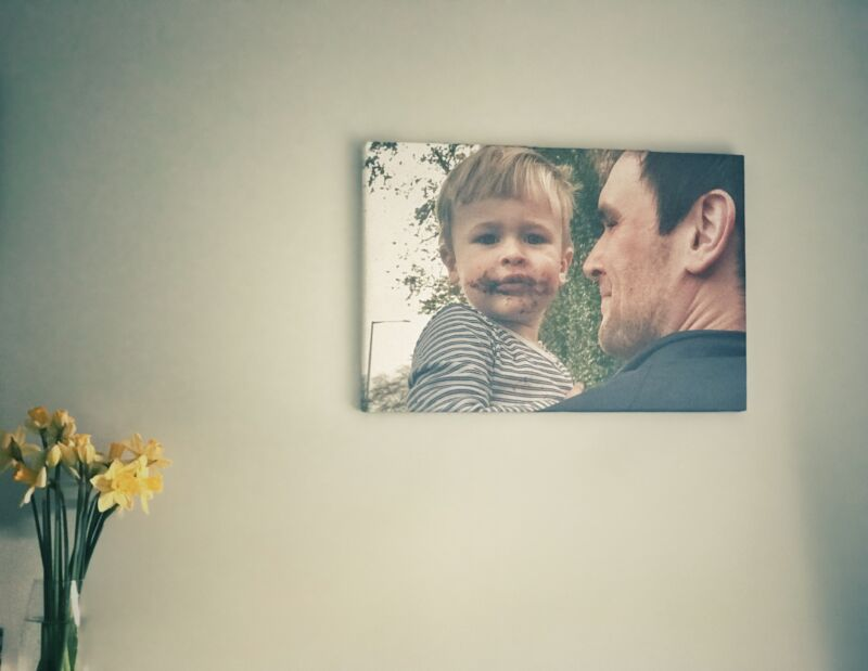 A shot of the third canvas we received from Parrot Print canvas of Dexter being held with by his Daddy