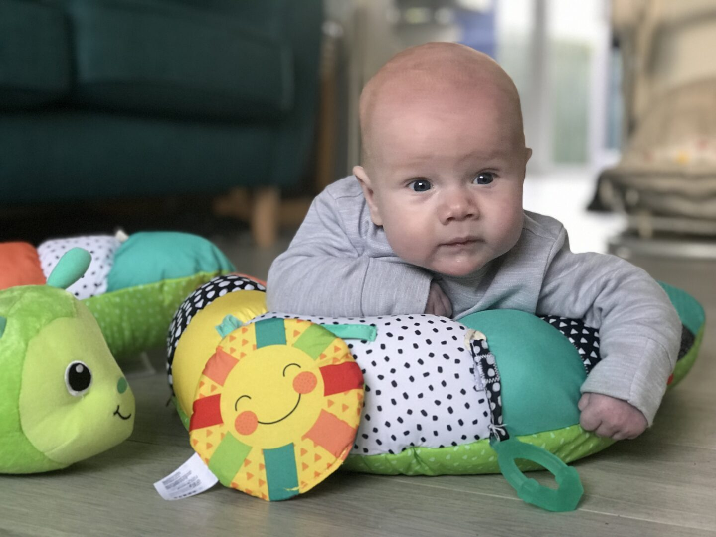 Felix using his Infantino Prop-a-Pillar tummy time support in the lounge