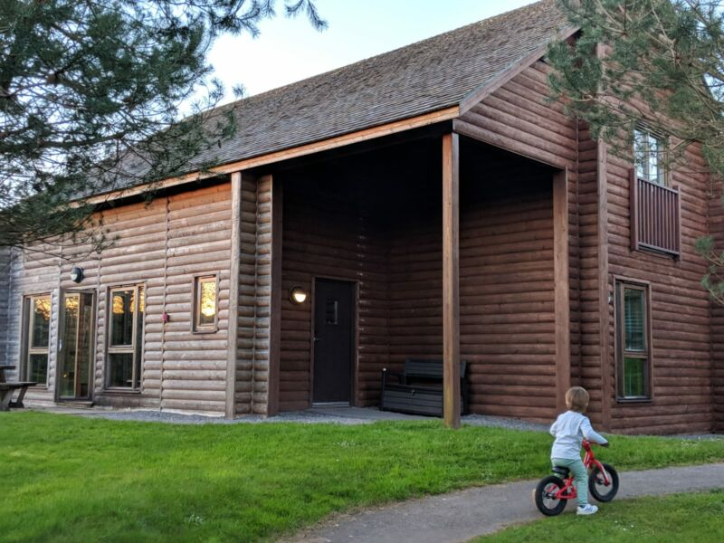Dexter riding his bike utside our skomer lodge in bluestone wales