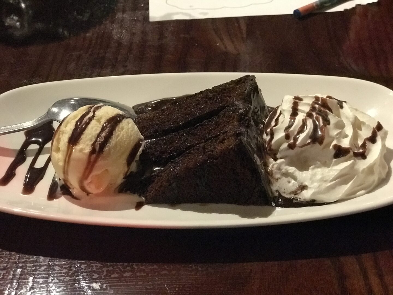 My dessert of chocolate fudge cake, ice cream and whipped cream in the buccaneer, blackpool