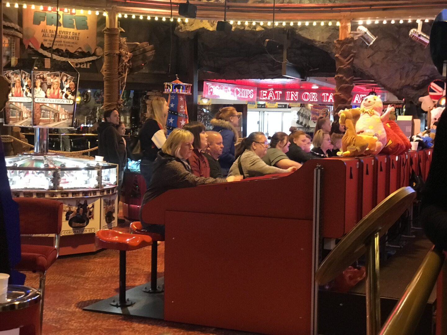 The general public playing the camel Derby in Coral Island, Blackpool