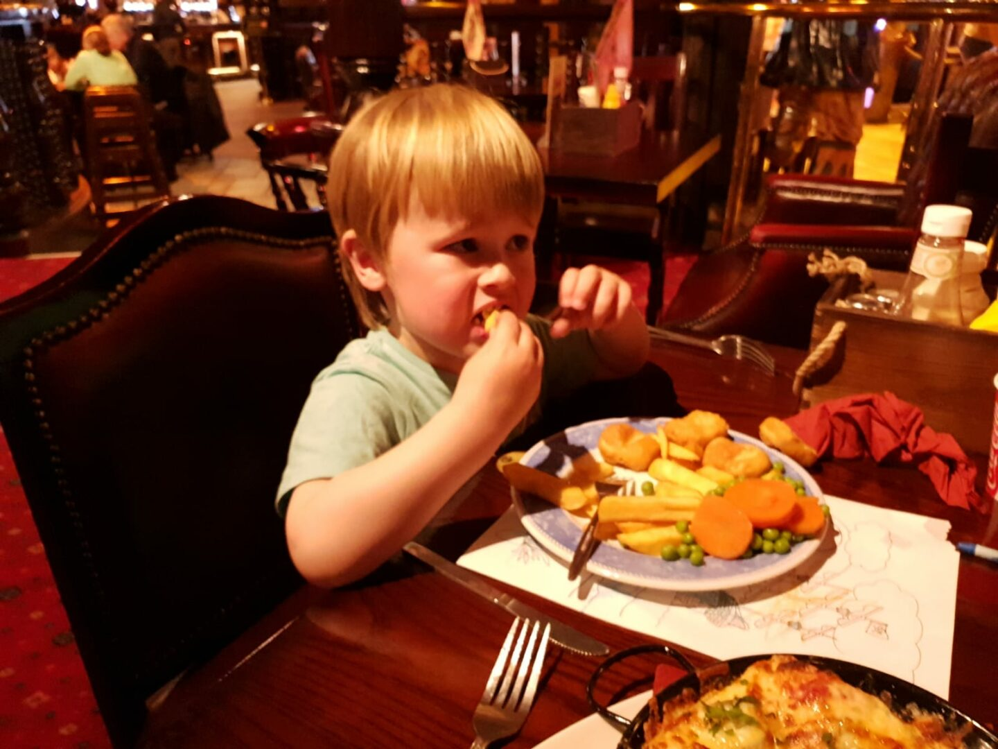 dexter eating his kids meal of chicken nuggets, chips and veg in the buccaneer, coral island, blackpool