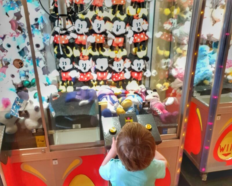 Dexter playing on a grabby machine in Coral Island, Blackpool