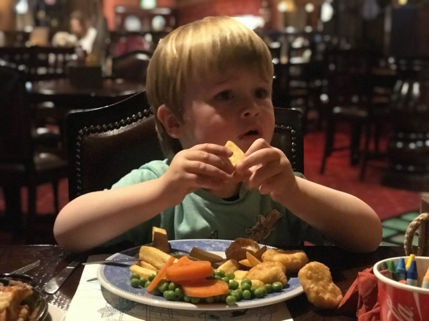 Dexter eating chicken nuggets, chips and veg in the buccaneer, blackpool