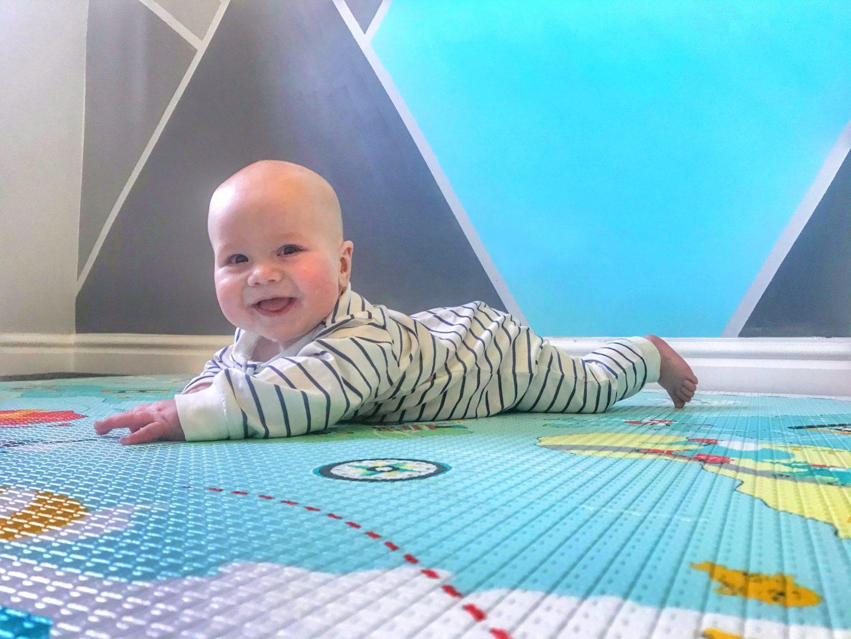 Happy Felix doing tummy time on the Skip Hop Reversible playmat