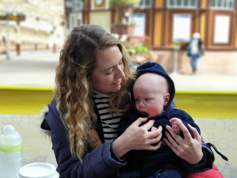 Nicola holding Felix in Wemyss Bay train station