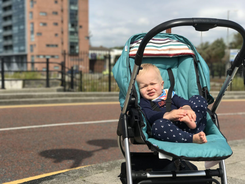 dexter at 13 months old sat in his pram in princes dock