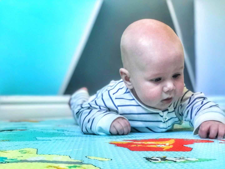 Felix doing tummy time on the Skip Hop Reversible playmat