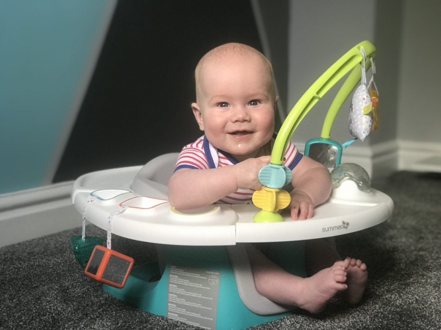Felix in his Summer Delux 4 in 1 Superseat looking at camera smiling