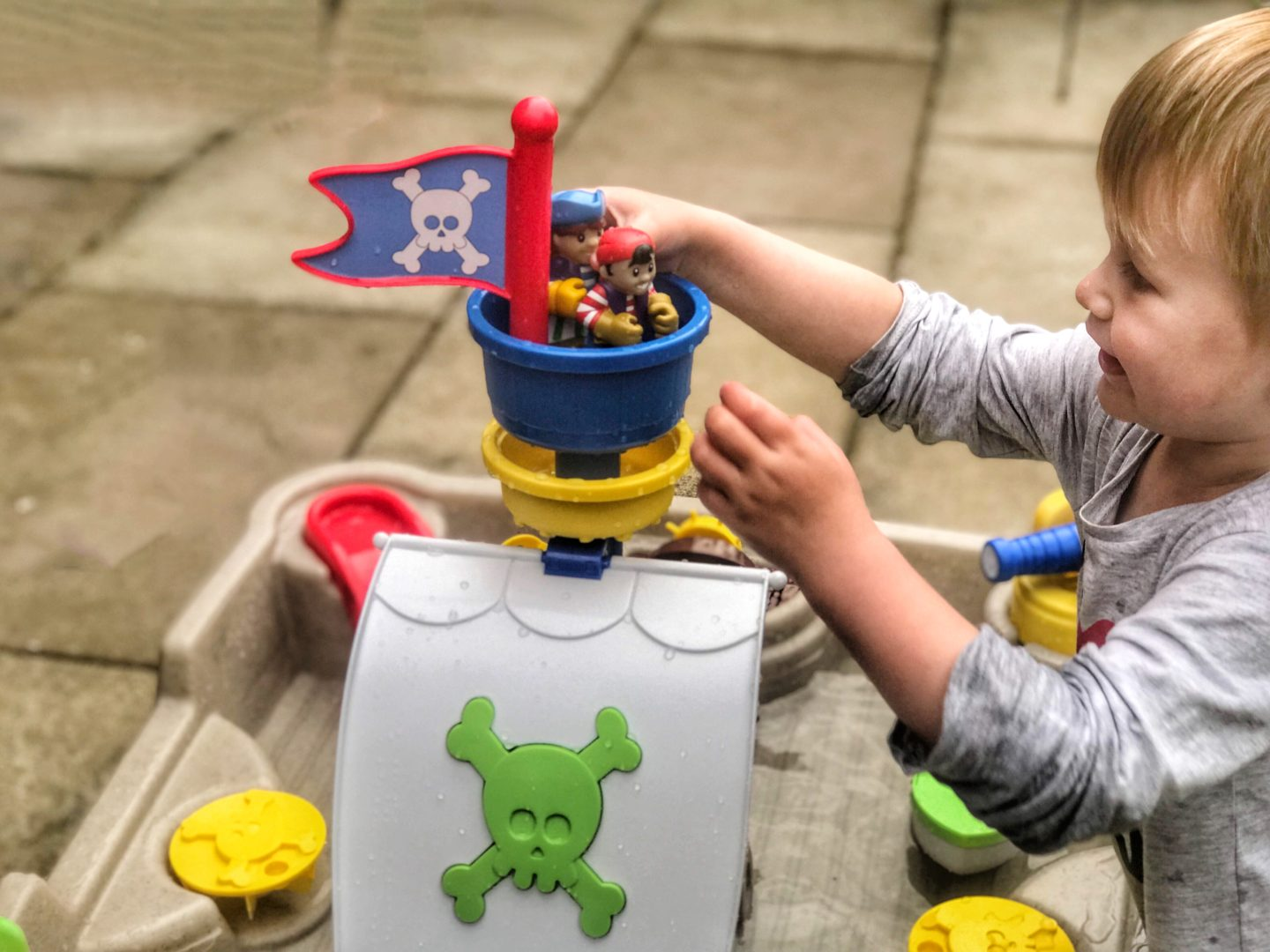 Dexter placing two pirates in the crow's nest of the little tikes anchors away pirate ship water table