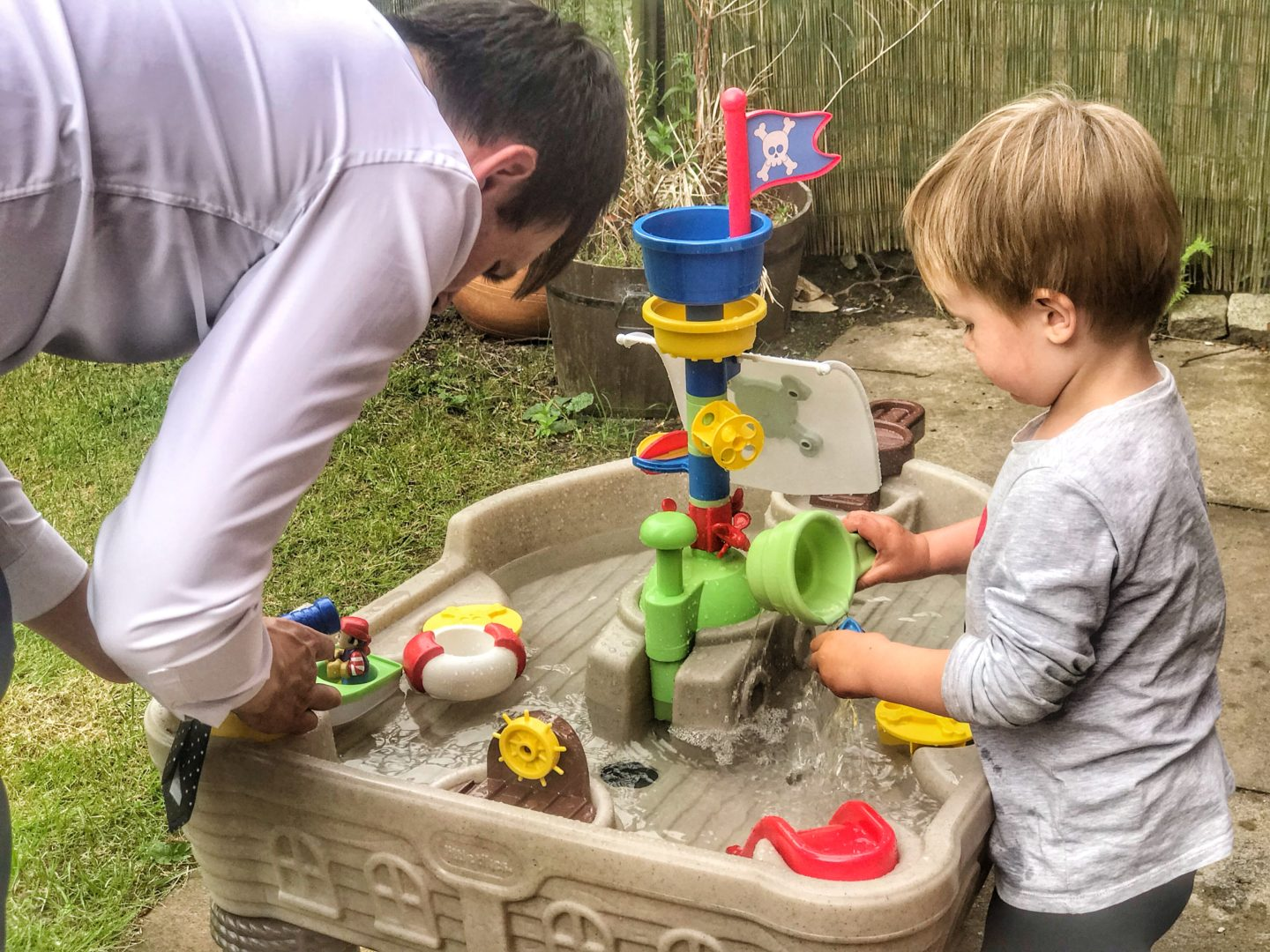Dexter and Daddy playing with the Little Tikes anchors away pirate ship water table