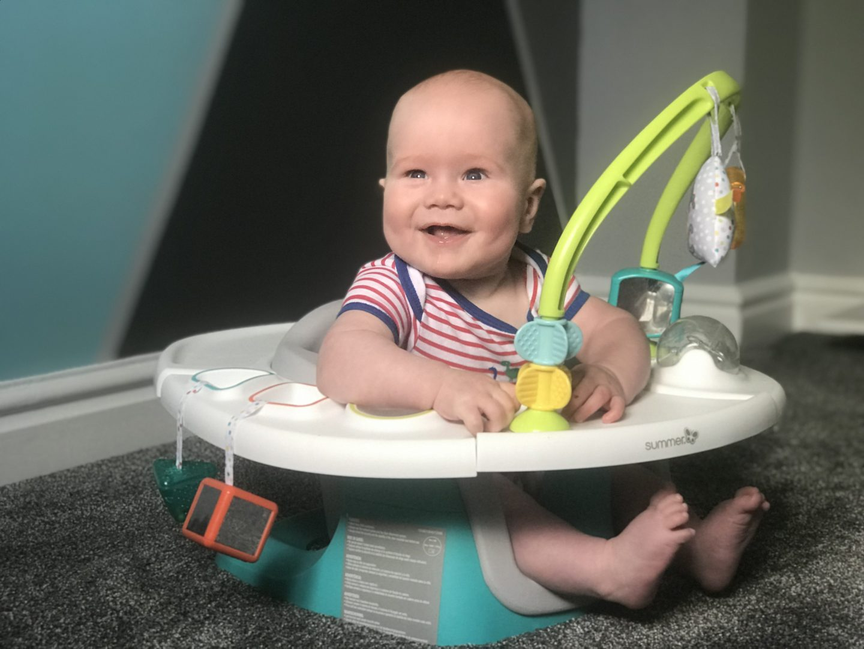 Felix in his Summer Delux 4 in 1 Superseat smiling