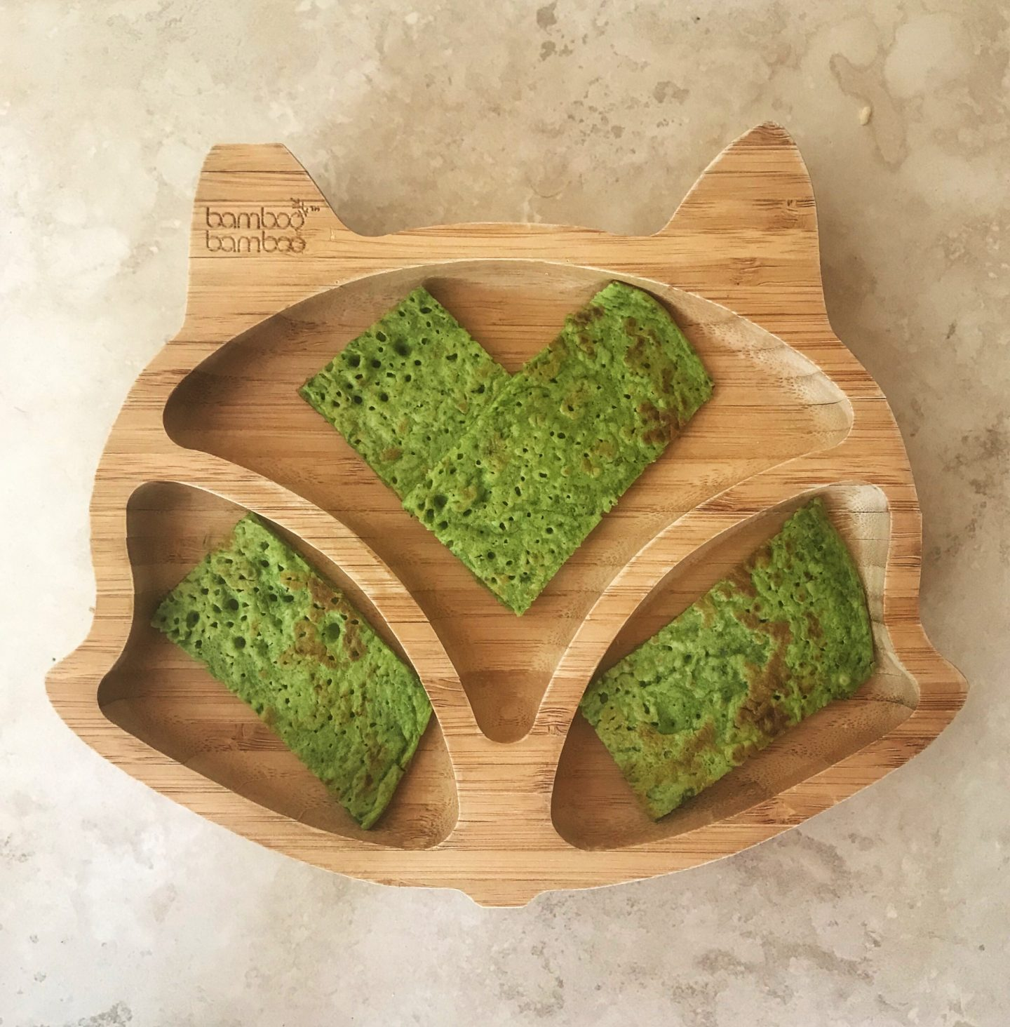 Baby Led weaning spinach pancakes on a bamboo bamboo plate
