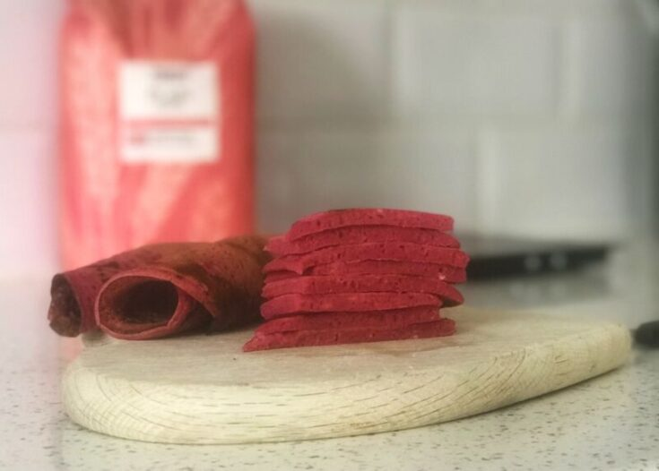 Baby Led weaning beetroot pancakes stacked on a chopping board