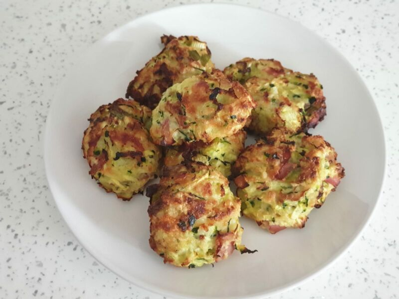 Baby Led weaning courgette bites on a plate in the kitchen