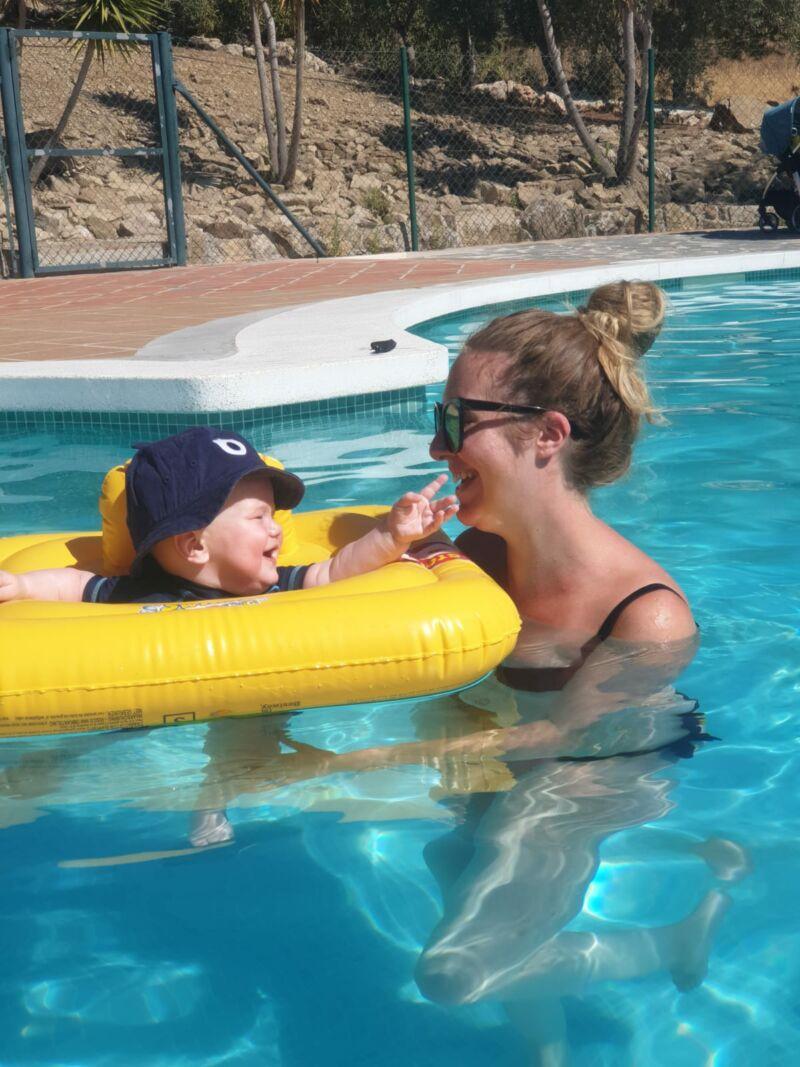 Felix in the pool in Alojamientos Huetor, touching Nicola's face