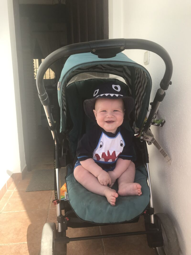 Felix sat in his pram outside Alojamientos Huetor with a big smile on his face