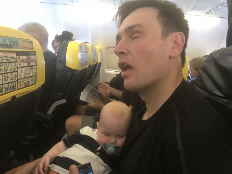 Neil and Felix asleep on Ryanair flight to Malaga