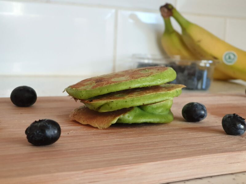 3 ingredient spinach and banana pancakes on a chopping board