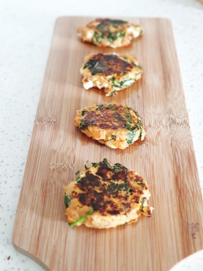 baby led weaning sweet potato and spinach burgers for babies on a wooden tray