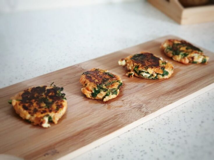 baby led weaning sweet potato and spinach burgers for babies on a wooden serving board
