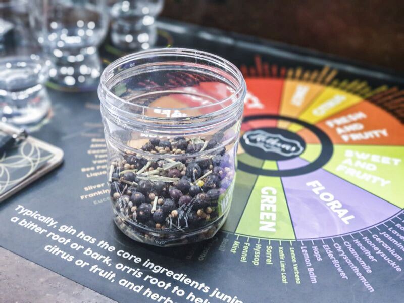 The botanicals we chose for our gin in a plastic container in Hotham Gin's School