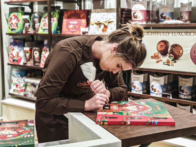 Crafter personalising our advent calender inside the new Thornton's shop in Liverpool One