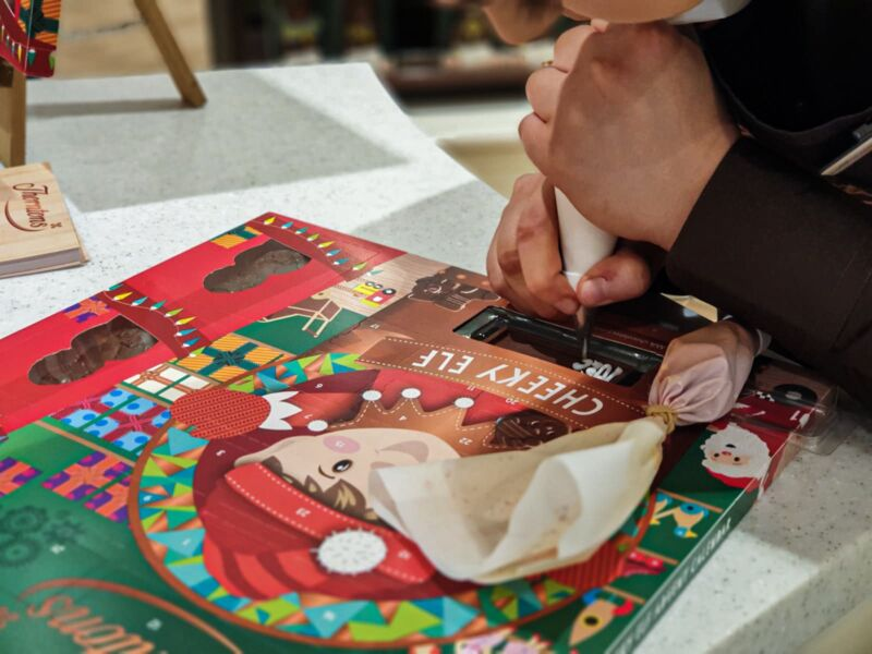 Craft chocolatier personalising our advent calendars in Thornton's new shop in Liverpool One