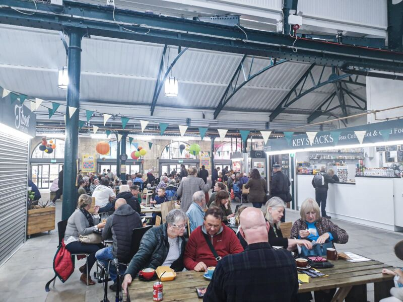 trinity market, group of diners under flag bunting