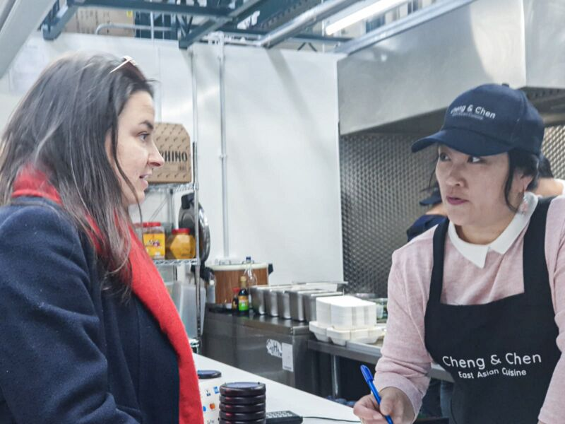 Gemma ordering her food at Cheng and Chen in Trinity Market hull