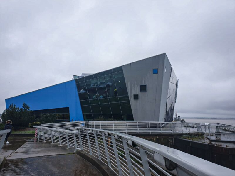 The Deep building on a dark, grey day next to Hull's marina