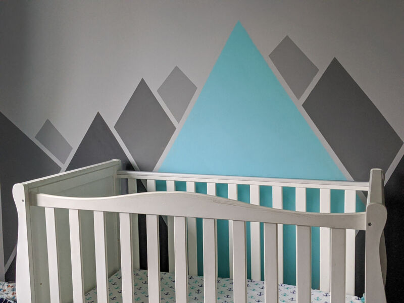 Painted turquoise and grey mountains behind Felix's cot
