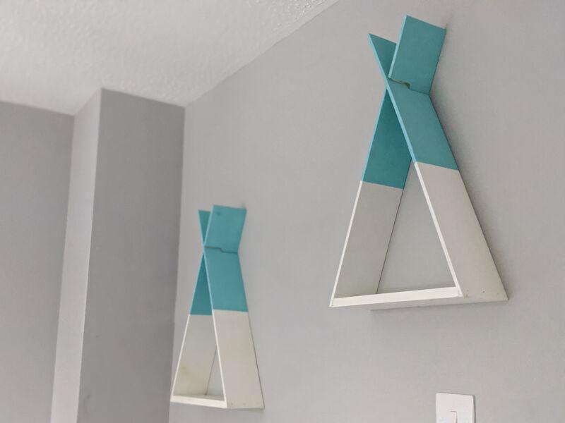 Felix's turquoise and white teepee shelves